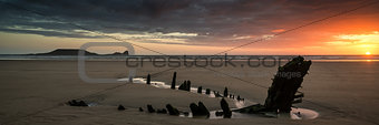 Landscape panorama ship wreck on Rhosilli Bay beach in Wales at