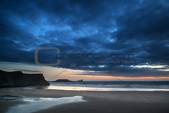 Beautiful dramatic sunset landscape over Rhosilli Bay beach