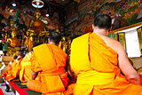 Monks prayed in the old temple ,Bangkok,Thailand.
