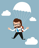 Lucky businessman is flying with parachute.