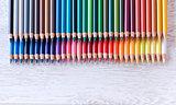 Colour pencils on white table