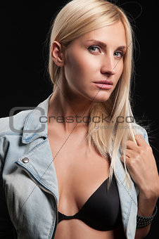 beautiful blonde on a black background