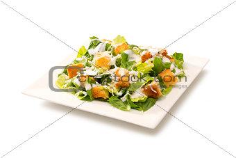 Caesar salad in a white plate