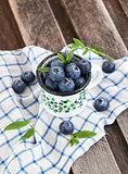 Fresh blueberry in the mug