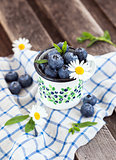 Fresh blueberry in the mug