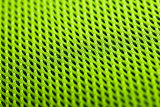 green background. Mesh fabric texture. Macro