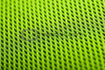 green background. Mesh fabric texture. Macro