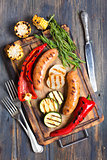 Sausage and vegetables cooked on the grill.