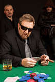 Cigar smoking whisky drinking poker player