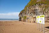 beach cliff falls warning sign
