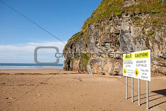 beach cliff falls warning sign
