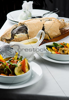 Baked whole sea bass fish in a salt crust