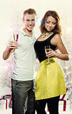 Young attractive couple with glasses of sparkling champagne