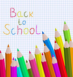 Back to school message with pencils on paper sheet background