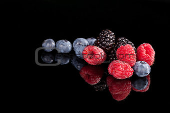 Berries isolated on black background.