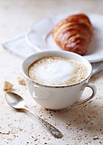 Cup of Latte Coffee and Croissant