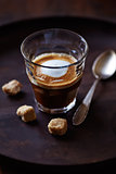 Glass of Espresso Macchiato with Brown Sugar