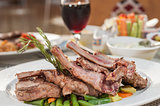 A la carte lamb chop meal on patterned plate
