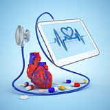 Medical tablet diagnostic heart with pills and stethoscope