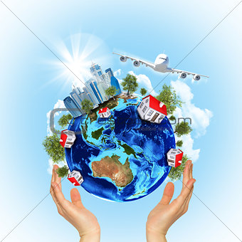 Woman hands hold Earth with buildings and airplane