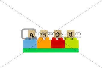 abcd word on wood stamps and colorful toy blocks