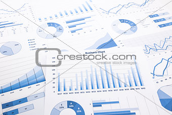 blue business charts, graphs, reports and paperwork