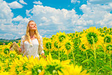 Woman in sunflower field