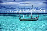 Little fishing boat in blue sea