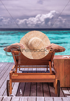 Woman on luxury beach resort