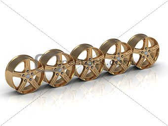Five golden disks (rims) from car are put in one row on white background