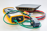 network tester and small switch with various color RJ45 cables c