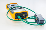 network tester with green RJ45 cable 5e connected for testing