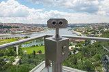 Binoculars on viewing platform overlooking river