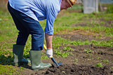 Farmer digging