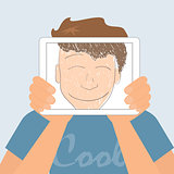 Guy holds tablet pc displaying fun smiling drawing.