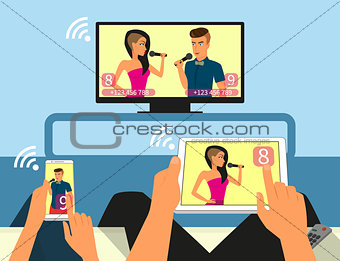 Multiscreen interaction. Man and woman are participating in TV singer show using smartphone and tablet pc.