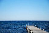 Wooden bath pier in blue water