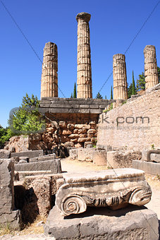 Ancient column and ruins of Temple of Apollo in Delphi, Greece