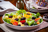 Vegetable salad with olives and cheese