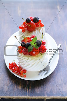 traditional summer dessert pavlova with fresh berries