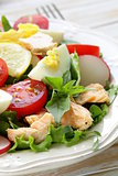 fresh green salad with salmon, egg and tomatoes