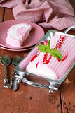 strawberry vanilla cake roll ice cream with mint and berry sauce