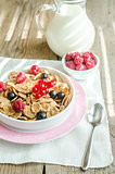 Wholegrain granola with milk and fresh berries