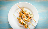 Grilled chicken skewers with herbs