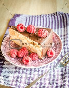 Chocolate cake decorated with fresh raspberries