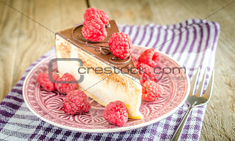 Chocolate cake decorated with fresh raspberries