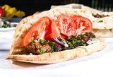 Lavash with grilled meat and vegetables