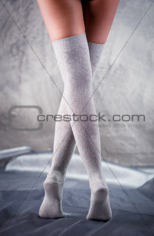 Beautiful woman legs in cotton stockings