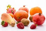 Mango, pomegranate, pitaya, orange, pear, kiwi and mandarine