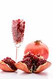 Pomegranate seeds and a whole pomegranate